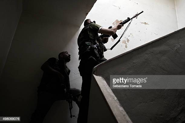 Free Syrian Army fighters clear a building from possible regime soldiers along the front line of Salahadeen in Aleppo Syria October 4 2012
