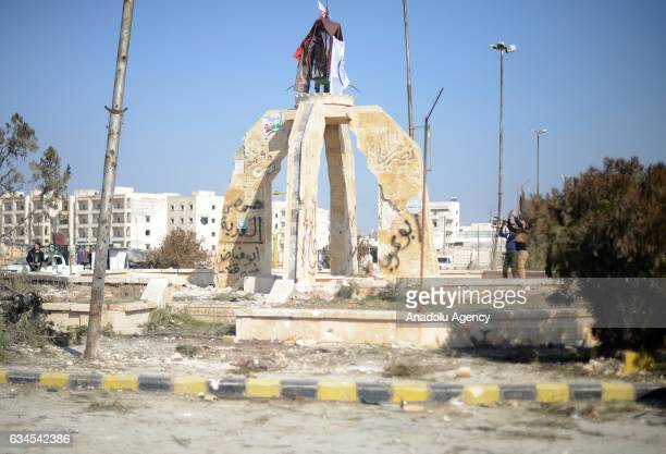 Free Syrian Army fighters supported by the Turkish Armed Forces hang a flag in AlBab town of Aleppo during the 171th day of the Operation Euphrates...