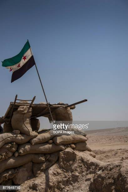 FSA Free Syrian Army Flag flies from a frontline bunker on the frontlines of Al Shaddadi where Quwat Al Nukhba are positioned They are only a...