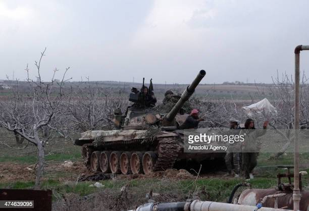 Free Syrian Army forces attack to a control point in Idlib during the clashes 2 tanks are destroyed on February 24 2014