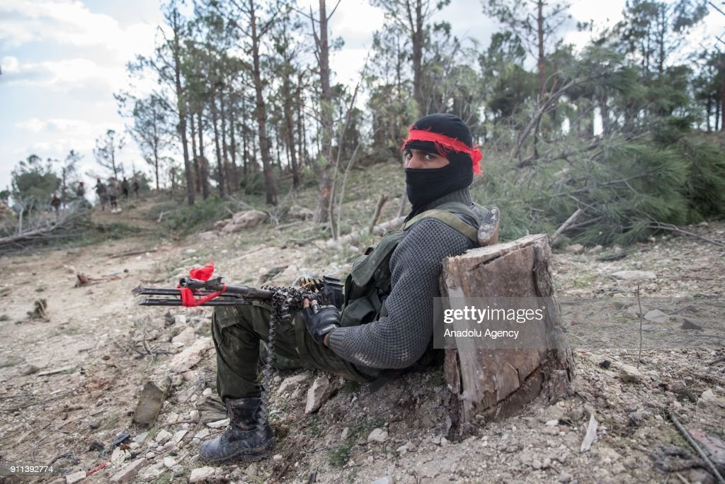 Free Syrian Army member, backed by Turkish Army, is seen at Burseya Mountain after Turkish military aircrafts hit PYD/PKK terror group targets and secure the mountain within the 'Operation Olive Branch' launched in Syria's Afrin, on January 28, 2018. Turkey launched Operation Olive Branch on January 20 in Syrias northwestern Afrin region; the aim of the operation is to establish security and stability along Turkish borders and the region as well as to eliminate PKK/KCK/PYD-YPG and Daesh terror groups, and protect the Syrian people from the oppression and cruelty of terrorists.