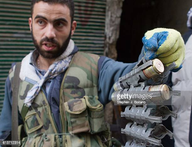 Free Syrian Army member holds up grenades from a launcher in Karmal AL Jabal It is estimated that 400000 people have died in the past 5 years during...