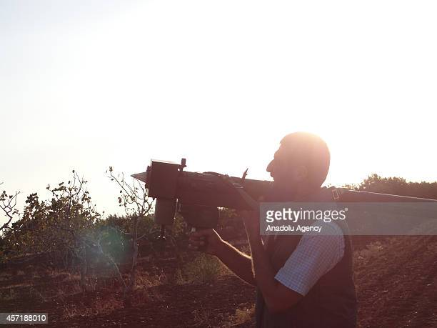 Free Syrian Army member is ready to fire the missile against Asad regime forces' warplanes staging airstrikes in Aleppo Syria on October 13 2014