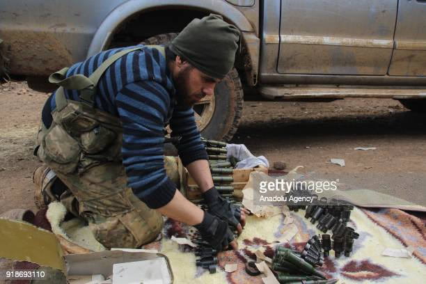 Free Syrian Army member loads bullets after liberating the villages of Sharbanli and Shadia within the 'Operation Olive Branch' in northwest of...