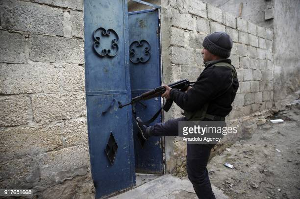 Free Syrian Army member patrols as search operations continue at Dikmetas village after Turkish Armed Forces and FSA members cleared the village on...