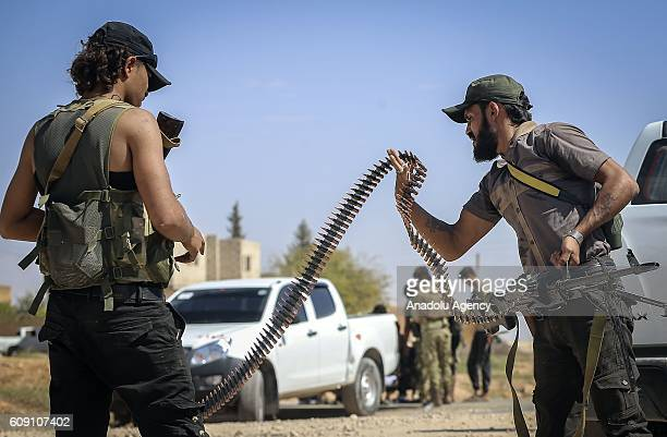 Free Syrian Army members are seen in Taslihoyuk village of Jarabulus as they carry out an operation within the Operation Euphrates Shield led by...