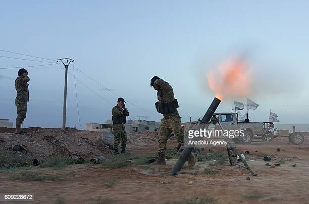 Free Syrian Army members attack with howitzers to Daesh around Behverte village of Cobanbey town in Jarabulus Aleppo Syria on September 20 2016