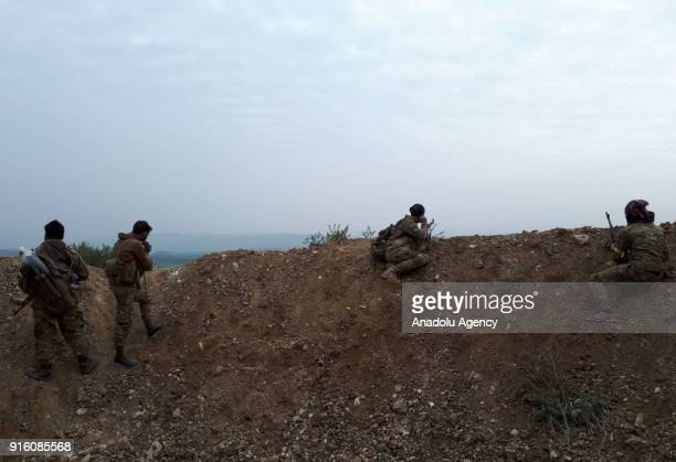 Free Syrian Army members backed by Turkish Armed Forces are seen during an operation against PYD/PKK terrorists within the the 'Operation Olive...