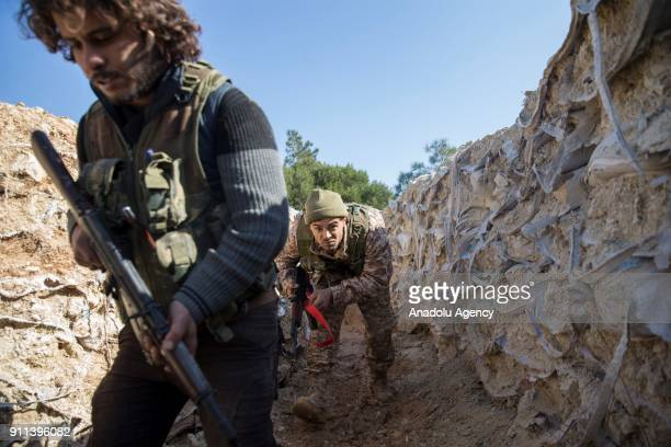 Free Syrian Army members backed by Turkish Army are seen after Turkish military aircrafts hit PYD/PKK terror group targets and secure the mountain...