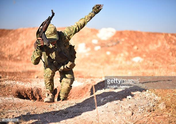 """Free Syrian Army members defuse mines planted by Daesh terrorists near Daesh controlled Bab district during the """"Operation Euphrates Shield"""" in..."""