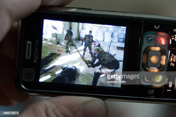 Free Syrian Army members of the Mujahadee Al Sunna katiba watch a video of government Army soldiers torturing and executing a Free Syrian Army...
