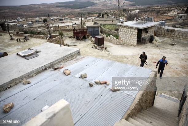Free Syrian Army members patrol as search operations continue at Dikmetas village after Turkish Armed Forces and FSA members cleared the village on...