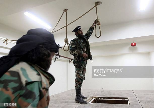 Free Syrian Army soldiers in a room where political prisoners were hanged by AlAssad forces inside the central prison on April 23 in Darkoush Syria...