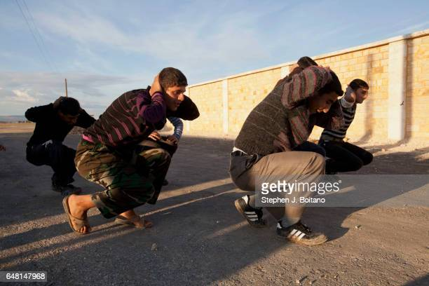 Free Syrian Army youth soldiers attend a training camp in Syria Their ages range from 14 to 18 and they spend several weeks working on fighting...