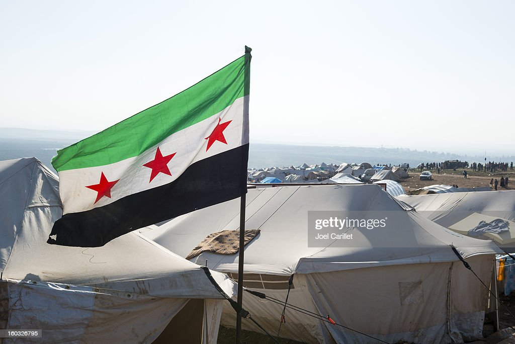 Free Syrian flag in refugee camp (Atmeh, Syria) : Stock Photo
