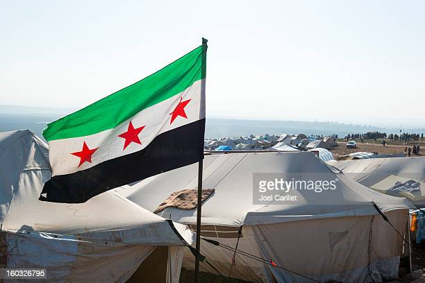 free syrian flag in refugee camp (atmeh, syria) - rebels with a cause stock photos and pictures