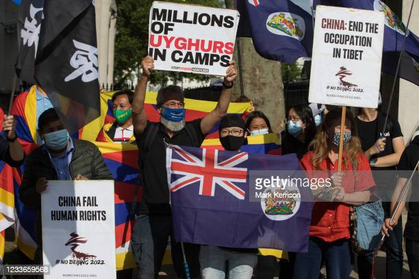 Free Tibet campaigners and members of the Hong Kong, Tibetan and Uyghur communities hold a rally opposite Downing Street as part of a global day of...