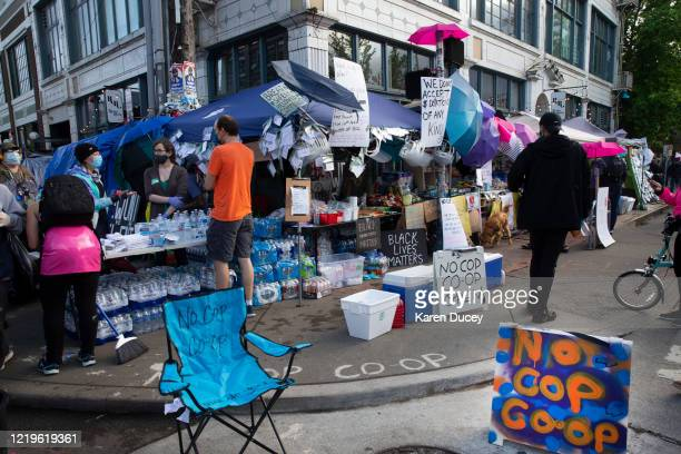 Free water masks and food are available at the NoCop Coop in an area dubbed the Capitol Hill Autonomous Zone on June 12 2020 in Seattle Washington...