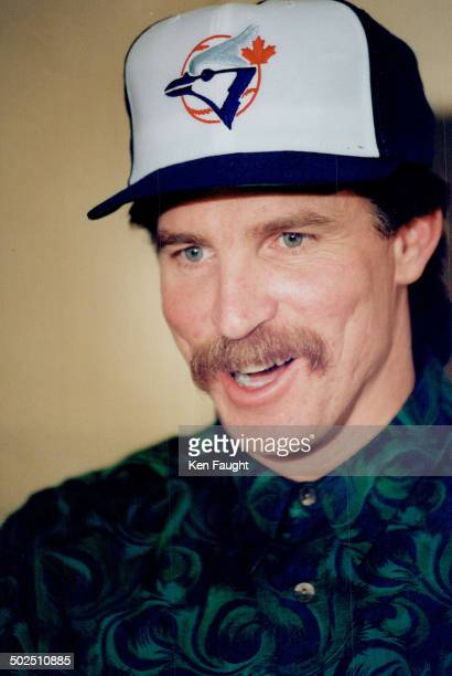 Freeagent pitcher Jack Morris tries a new hat on for size after signing a multimilliondollar deal with Toronto Blue Jays yesterday