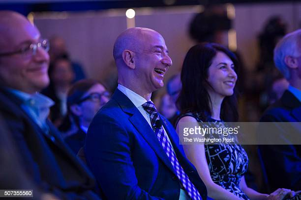 Freed Amazon founder and Washington Post owner Jeff Bezos laughs during an opening ceremony for the new headquarters of The Washington Post via Getty...
