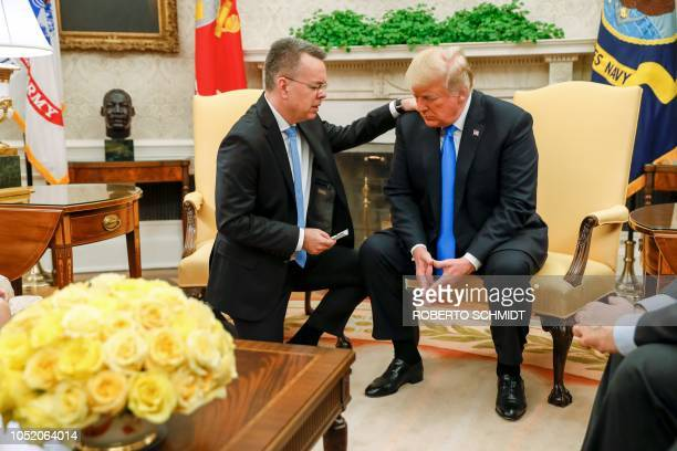TOPSHOT Freed American pastor Andrew Brunson prays for US President Donald Trump at the White House in Washington DC October 13 2018 Brunson held for...