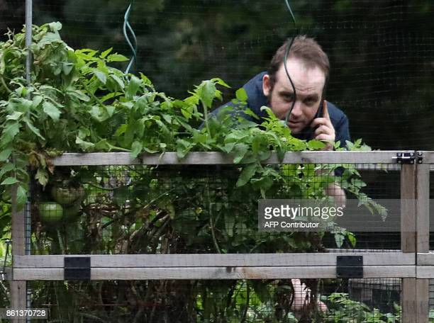 Freed Canadian hostage Joshua Boyle talks on the phone outside the Boyle family home in Smiths Falls Ontario Canada on October 14 2017 Boyle whose...