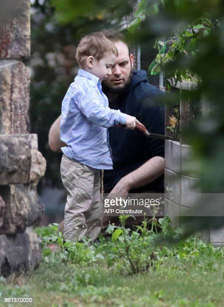 Freed Canadian hostage Joshua Boyle watches as one of his children plays outside the Boyle's family home in Smiths Falls Ontario Canada on October 14...