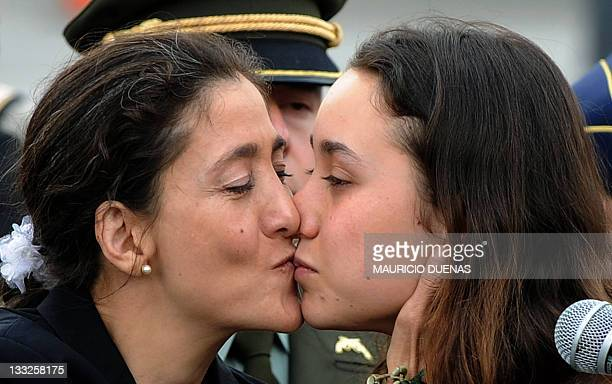 Freed Colombia hostage Ingrid Betancourt and her daughter Melanie Delloye kiss each other at the airport in Bogota on July 3, 2008 on their reunion...