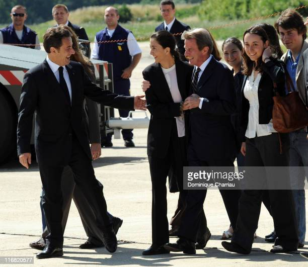 Freed hostage Ingrid Betancourt is accompanied by French president Nicolas Sarkozy and Bernard Kouchner on her arrival at the military base of...