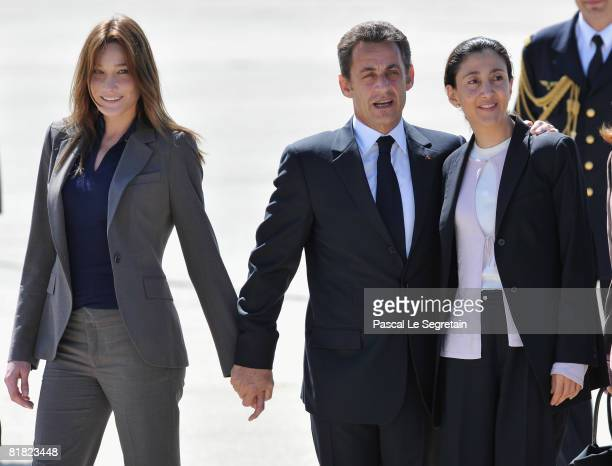 Freed hostage Ingrid Betancourt is greeted by president Nicolas Sarkozy and his wife Carla Bruni-Sarkozy on arriving at the military base of...