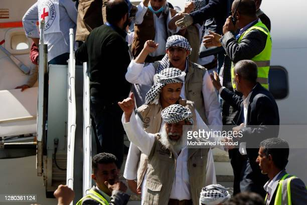 Freed Houthi fighterss arrive at Sana'a Airport after they were released during a prisoner swap between Yemen's warring sides, on October 15, 2020 in...