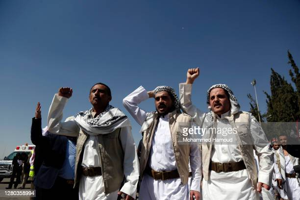 Freed Houthi fighterss chant slogans upon their arrival at Sana'a Airport after they were released during a prisoner exchange between Yemen's warring...