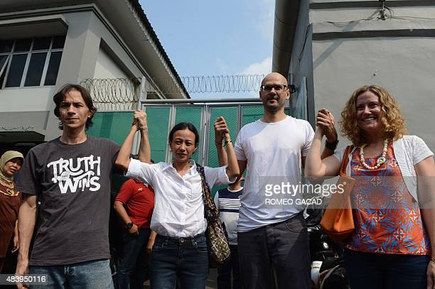 Freed Indonesian teaching assistant Ferdinand Tjiong and Canadian school administrator Neil Bantleman are joined by their wives Fransiska Tjiong and...
