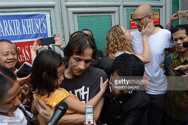 Freed Indonesian teaching assistant Ferdinand Tjiong carries his daughter Crisi with his wife Fransiska Tjiong while Canadian school administrator...