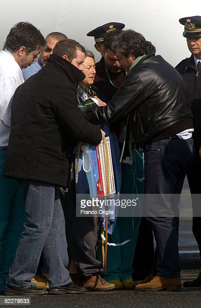 Freed Italian hostage Giuliana Sgrena is escorted to an ambulance at Ciampino airport a day after she was rescued from her Iraqi kidnappers March 5,...