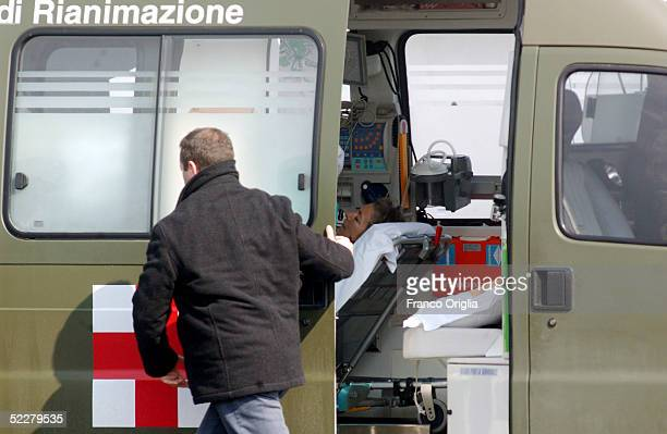 Freed Italian hostage Giuliana Sgrena is escorted to an ambulance on a stretcher at Ciampino airport a day after she was rescued from her Iraqi...