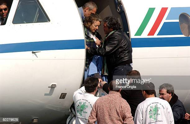 Freed Italian hostage Giuliana Sgrena is helped out of the plane at Ciampino airport a day after she was rescued from her Iraqi kidnappers March 5,...