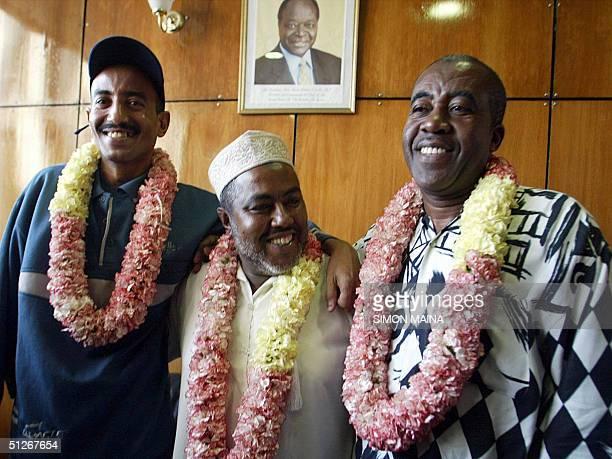 Freed Kenyan truck drivers from left Faiz Khamis Jalal Awadh and Ibrahim Khammis smile after arriving 07 September 2004 at the Jommo Kenyatta Airport...