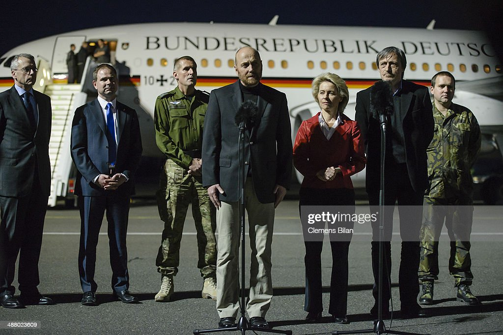 Freed OSCE observer, Axel Schneider (C), speaks during a press conference, next to Danish Defense Minister Nicolai Wammen (2nd from L), German Defence Minister Ursula von der Leyen (5th from L) and Czech Defense Minister Martin Stropnicky (6th flrom L), following his release from captivity in eastern Ukraine at Tegel Airport on May 3, 2014 in Berlin, Germany. The detained delegation, who include mission workers from Germany, the Czech Republic, Denmark and other countries, were taken hostage by pro-Russian separatists a week ago near Slovyansk and freed earlier today.
