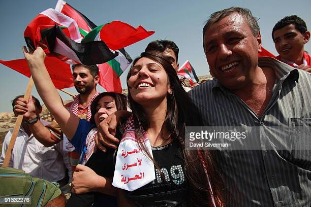 Freed Palestinian woman prisoner Linan Abu Ghulma is greeted by celebrating relatives after her release from Israeli prison on October 2 2009 in...