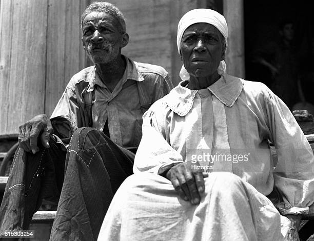 A freed slave and his wife living in a rundown plantation house in Greene County Georgia July 1937