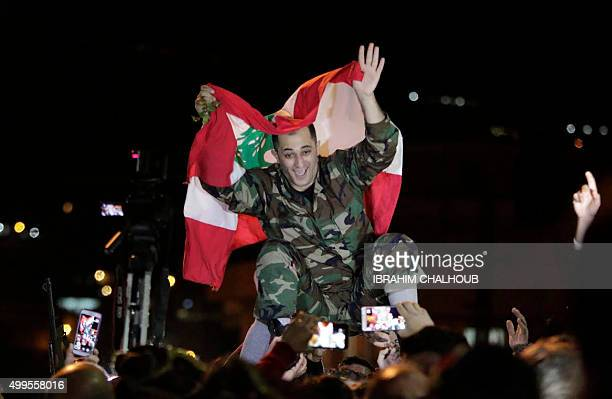 Freed soldier George alKhoury who was kidnapped by jihadist groups in early August 2014 in the eastern border town of Arsal celebrates his release on...