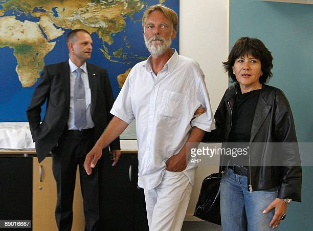 Freed Swiss hostage Werner Greiner arrives with his wife Gabriella Burco for a press conference upon his arrival on July 14, 2009 at Zurich airport....