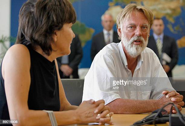 Freed Swiss hostage Werner Greiner attends with his wife Gabriella Burco a press conference upon his arrival on July 14, 2009 at Zurich airport....