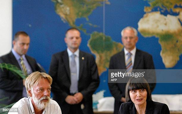 Freed Swiss hostage Werner Greiner gives a press conference with Swiss Minister of Foreign Affairs Micheline Calmy-Rey upon his arrival on July 14,...