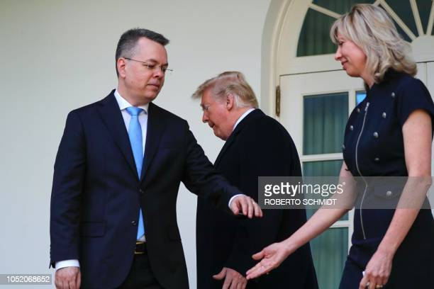 Freed US pastor Andrew Brunson and his wife Norine hold hands as they follow US President Donald Trump to the Oval Office in Washington DC on October...