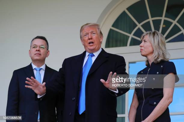 Freed US pastor Andrew Brunson and his wife Norine listen to US President Donald Trump speak to members of the press outside the Oval Office in...