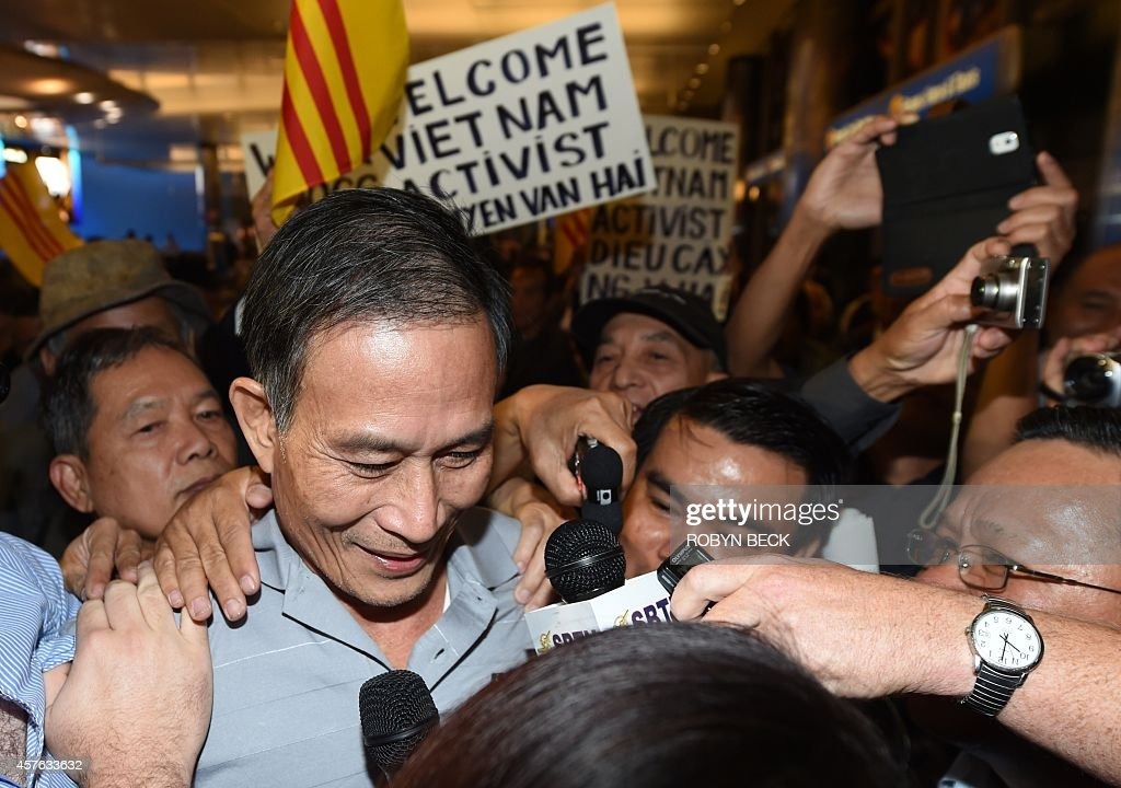 Freed Vietnamese dissident Nguyen Van Hai arrives at Los Angeles International Airport on October 21, 2014 in Los Angeles, California. The Vietnamese blogger, also known by his pen name 'Dieu Cay,' was handed a 12-year prison sentence in September 2012 for conducting anti-state propaganda amid a crackdown on bloggers in the one-party state. He was first arrested in 2008. AFP PHOTO / Robyn Beck