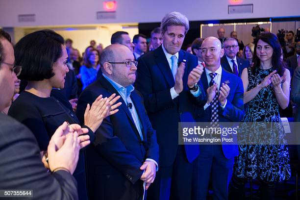 Freed Washington Post correspondent Jason Rezaian receives a round of applause during an opening ceremony for the new headquarters of The Washington...