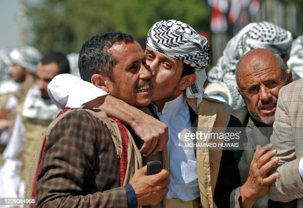 Freed Yemeni Huthi prisoners are greeted by relatives upon their arrival on Ocotber 15, 2020 at the airport of the capital Sanaa, after being...